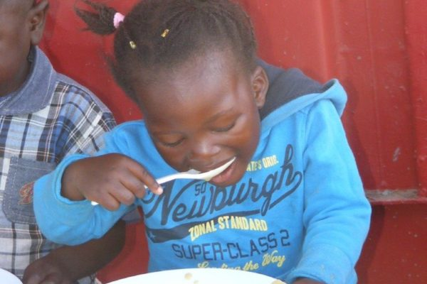 Now we get a tasty meal every day that we eat with our friends at our feeding centre