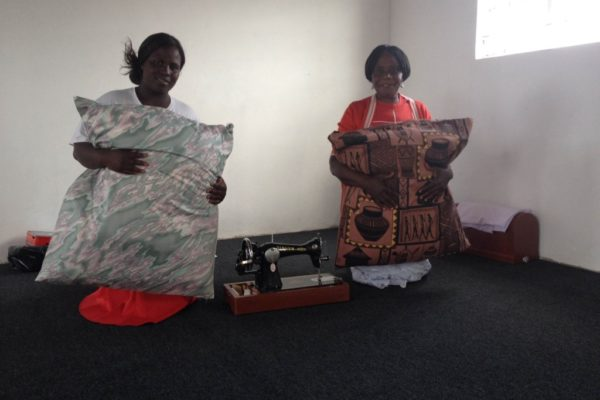 Our sewing project ladies making cushions for the skills development centre