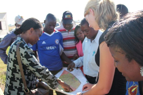 The team pouring over the plans to decide where everything was to go.  Thanks to Kerry Van Leenhoff's genius, we now have beautiful, professional plans for what promises to be a fantastic venue for the care that the children of Mabvuku need