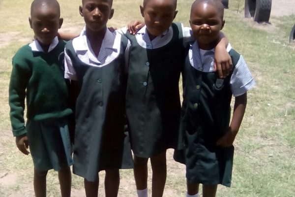 Makanaka is 2nd from the left and is now a very grown up Grade 2 student