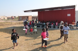 The new feeding programme container - children washing up after eating